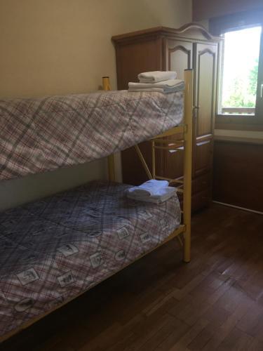 A bunk bed or bunk beds in a room at Apartamentos Turisticos Sol y Nieve