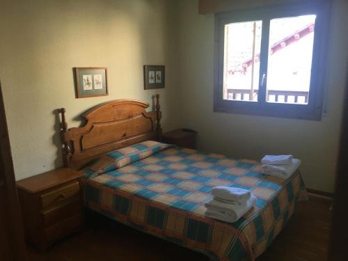 A bed or beds in a room at Apartamentos Turisticos Sol y Nieve