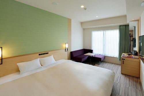 Cama o camas de una habitación en Candeo Hotels Osaka Namba