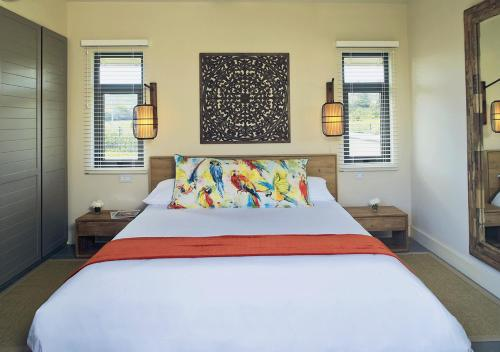 A bed or beds in a room at Heritage The Villas