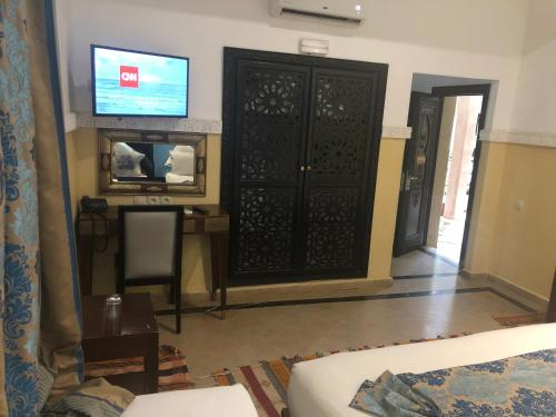 A television and/or entertainment center at Riad Nesma Suites & Spa