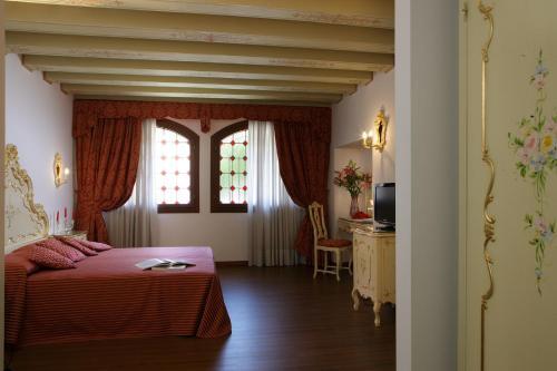 Letto o letti in una camera di Hotel La Residenza