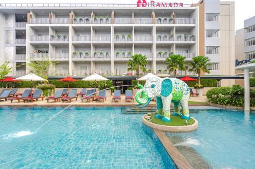 The swimming pool at or near Ramada by Wyndham Phuket Deevana Patong
