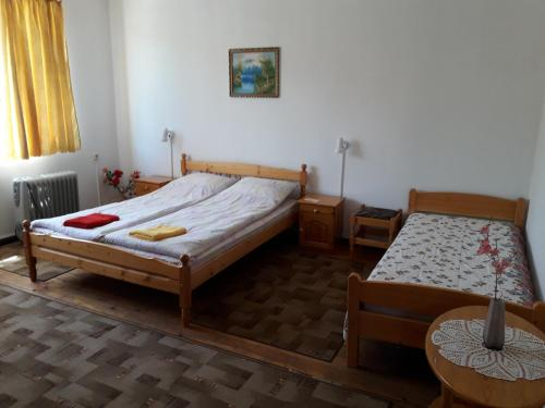 A bed or beds in a room at Proboyski Guest House