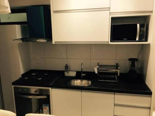 A kitchen or kitchenette at Flat Green Ville Prime Select