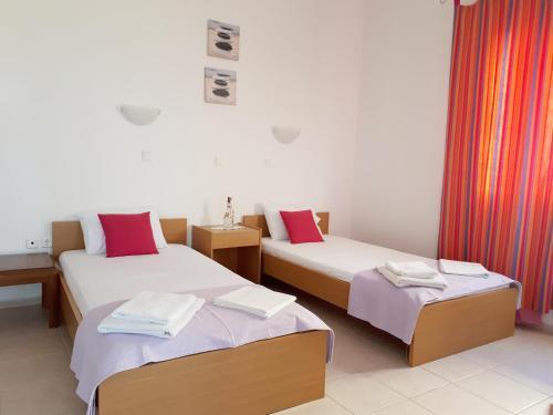 Ένα ή περισσότερα κρεβάτια σε δωμάτιο στο Studio Zafiria