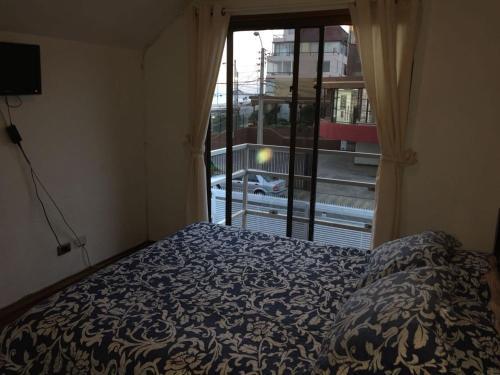Cama o camas de una habitación en Apart Hotel Brisas del Mar