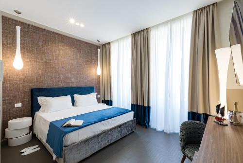 Cama o camas de una habitación en A World Aparts - Barberini Boutique Hotel