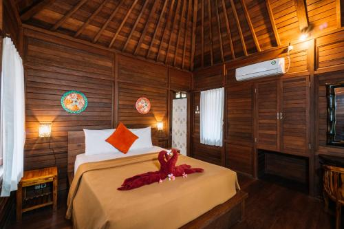 A bed or beds in a room at Bunda 7 Bungalows