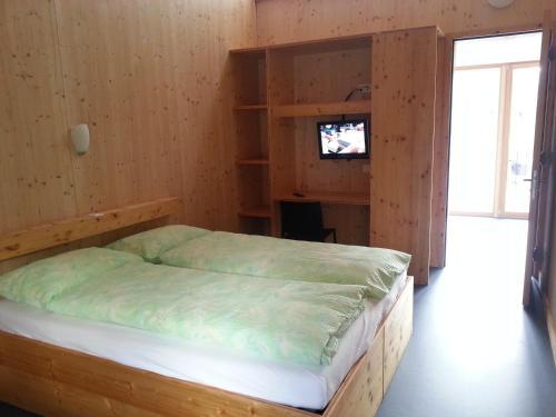 Letto o letti in una camera di Familienhotel Campagna