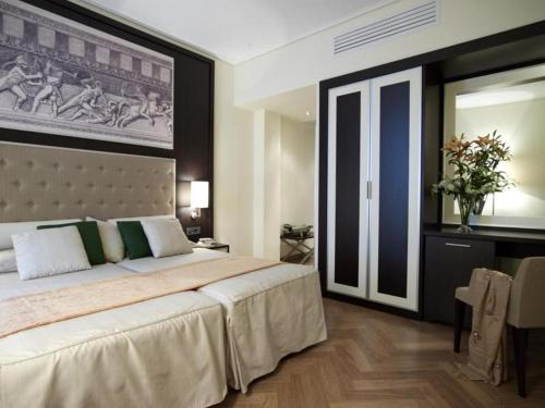Ένα ή περισσότερα κρεβάτια σε δωμάτιο στο Ξενοδοχείο Μενελάιον