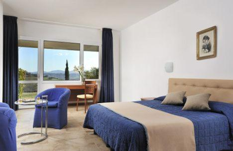 A bed or beds in a room at Aquaviva Hotel & Spa
