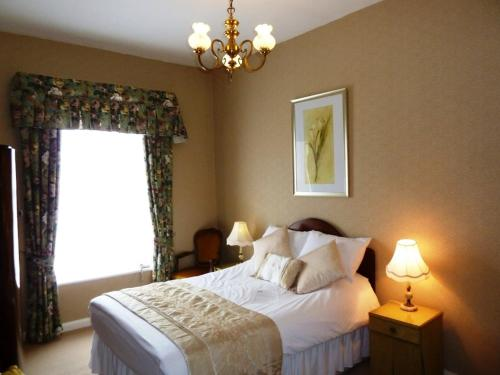 A bed or beds in a room at The Teesdale Hotel