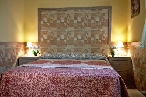A bed or beds in a room at casa oliva la bodegueta