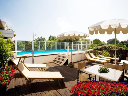 The swimming pool at or near Hotel Savoy
