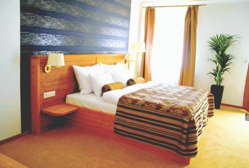 Postel nebo postele na pokoji v ubytování Hotel Eagle