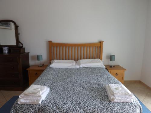 Uma cama ou camas num quarto em Peniche Chill House - S.Bernardino