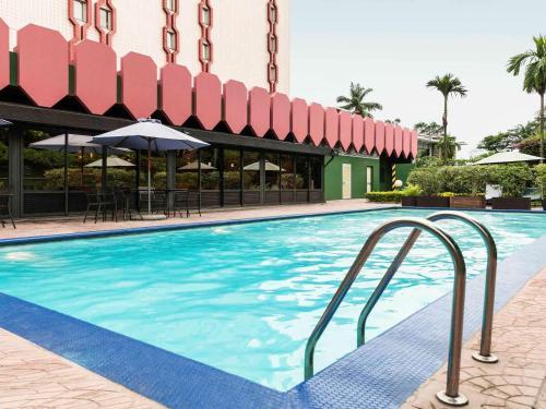 The swimming pool at or near ibis Douala