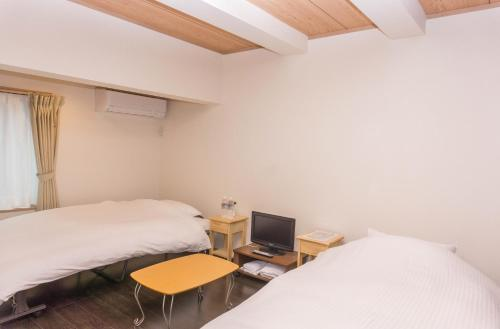 OYO 旅館ひのもとにあるベッド