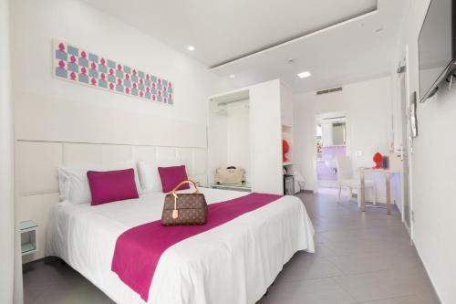 Letto o letti in una camera di Hotel Tasso Suites & Spa