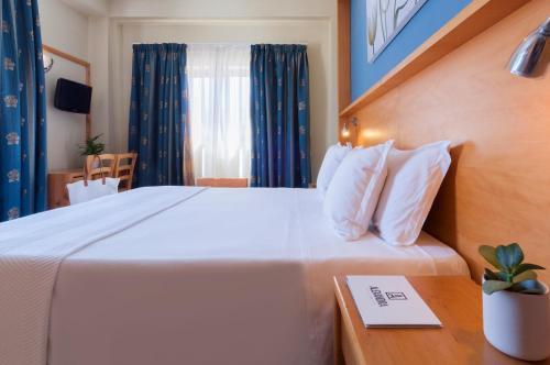 Letto o letti in una camera di Alexandra Hotel