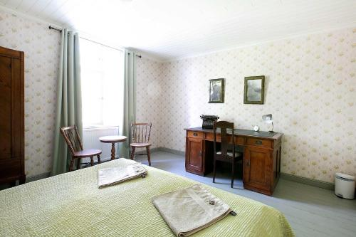 Säng eller sängar i ett rum på Tammiston Bed&Breakfast
