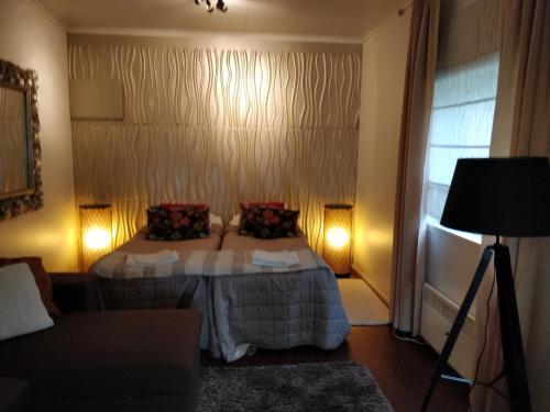 Vuode tai vuoteita majoituspaikassa Majatalo & Ravintola Villa Emilia