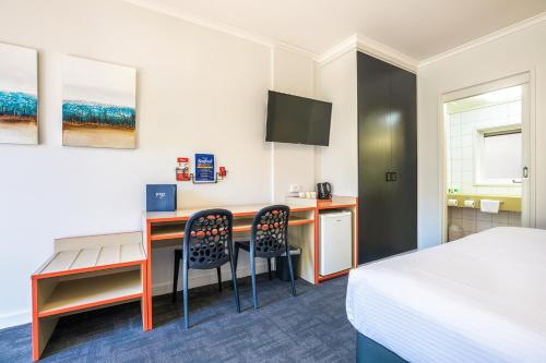 A television and/or entertainment center at Nightcap at Ferntree Gully Hotel Motel