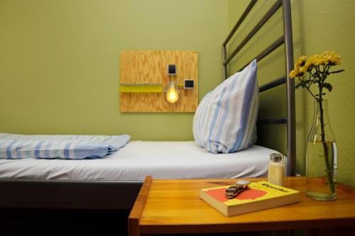 A bed or beds in a room at Amstel House Hostel