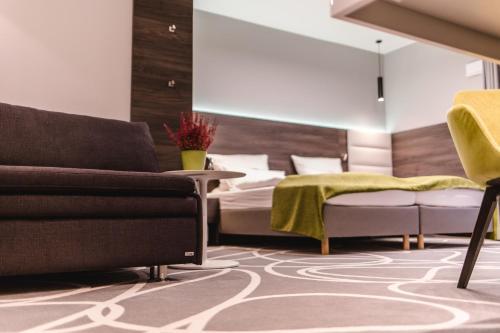 Ein Bett oder Betten in einem Zimmer der Unterkunft Hotel Sachsenross