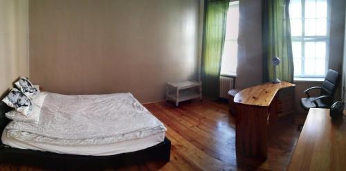 Łóżko lub łóżka w pokoju w obiekcie Apartament Kozia I