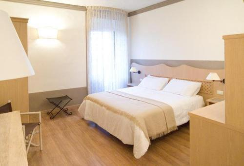 A bed or beds in a room at Albergo Le Terme