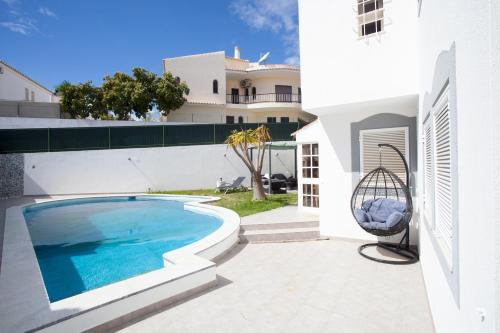 The swimming pool at or near Villa Monaco