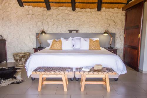 A bed or beds in a room at Leopard Mountain Safari Lodge