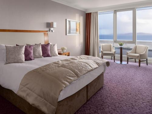 A bed or beds in a room at Salthill Hotel