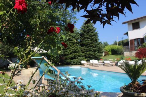 The swimming pool at or near Villa Nicolai tra Mare e Montagna