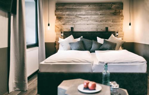 Ein Bett oder Betten in einem Zimmer der Unterkunft Berg-Leben
