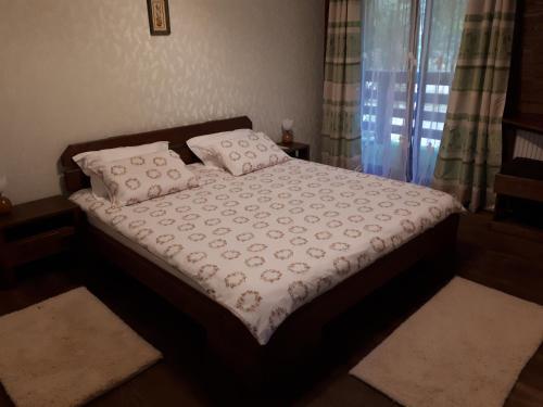 Un pat sau paturi într-o cameră la Pension Terra Nova