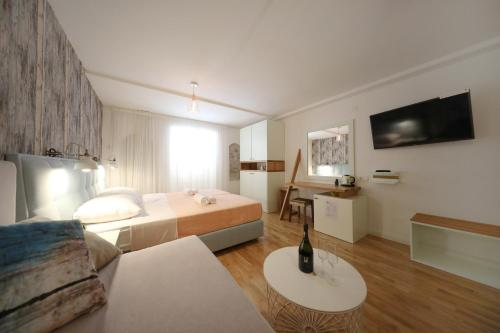 A bed or beds in a room at Central Apartments Integrated Hotel