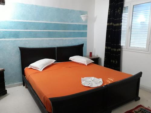A bed or beds in a room at Résidence Nour