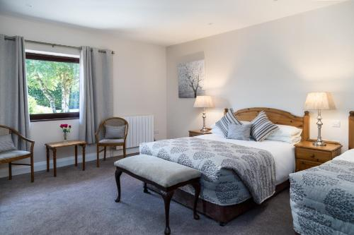 A bed or beds in a room at Kathleens Country House