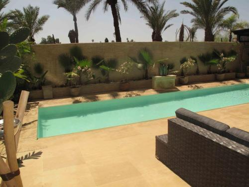 The swimming pool at or near Terrasse Harti Hivernage