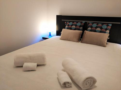 A bed or beds in a room at Sleep & Go Faro Airport Guest House