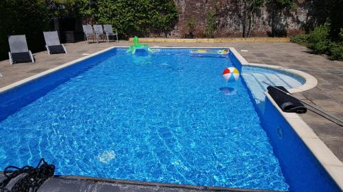 The swimming pool at or near Glebe House Cottages
