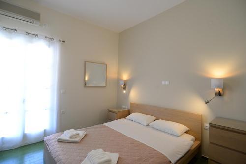 Łóżko lub łóżka w pokoju w obiekcie Villa Anesis