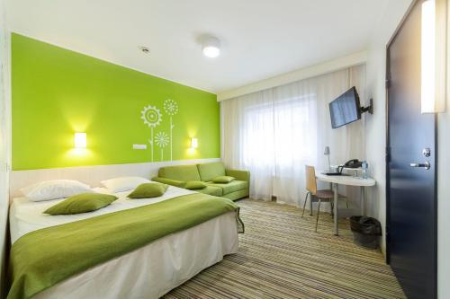 Vuode tai vuoteita majoituspaikassa Tallink Express Hotel