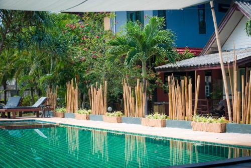 The swimming pool at or near Oasis Yoga Bungalows