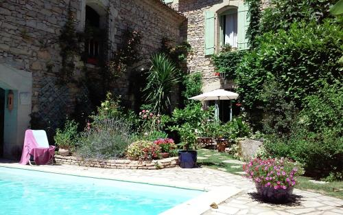 The swimming pool at or near Le Clos d'Isabelle