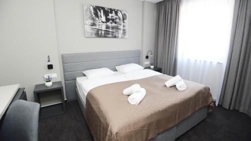 Letto o letti in una camera di Hotel Bigeste