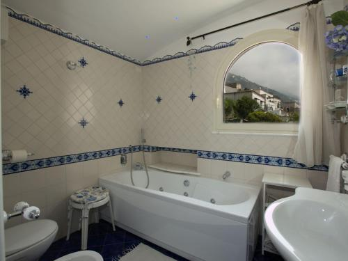 A bathroom at Gorgeous Holiday Home in Praia with a Breathtaking Seaview